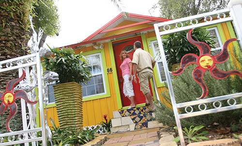 Exterior view of a vibrantly painted shop in Village of the Arts in Bradenton, FL