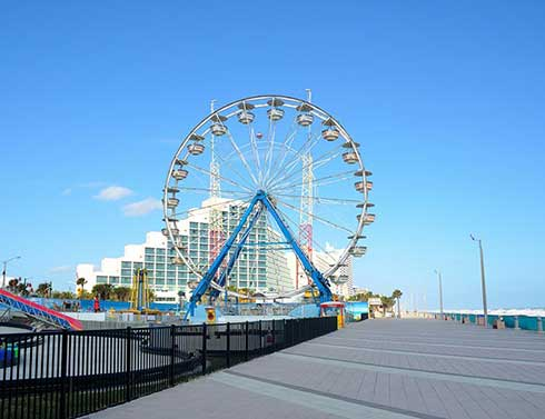 A Ferris wheel with buildings in the background in Daytona Beach, Florida