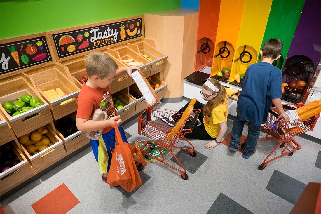 Children shop for pretend groceries at the Omaha Children's Museum in Omaha, Nebraska