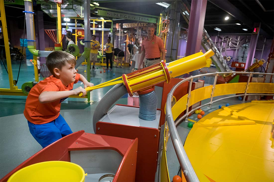 A young boy plays with an interactive exhibit at the Omaha Children's Museum in Omaha, Nebraska