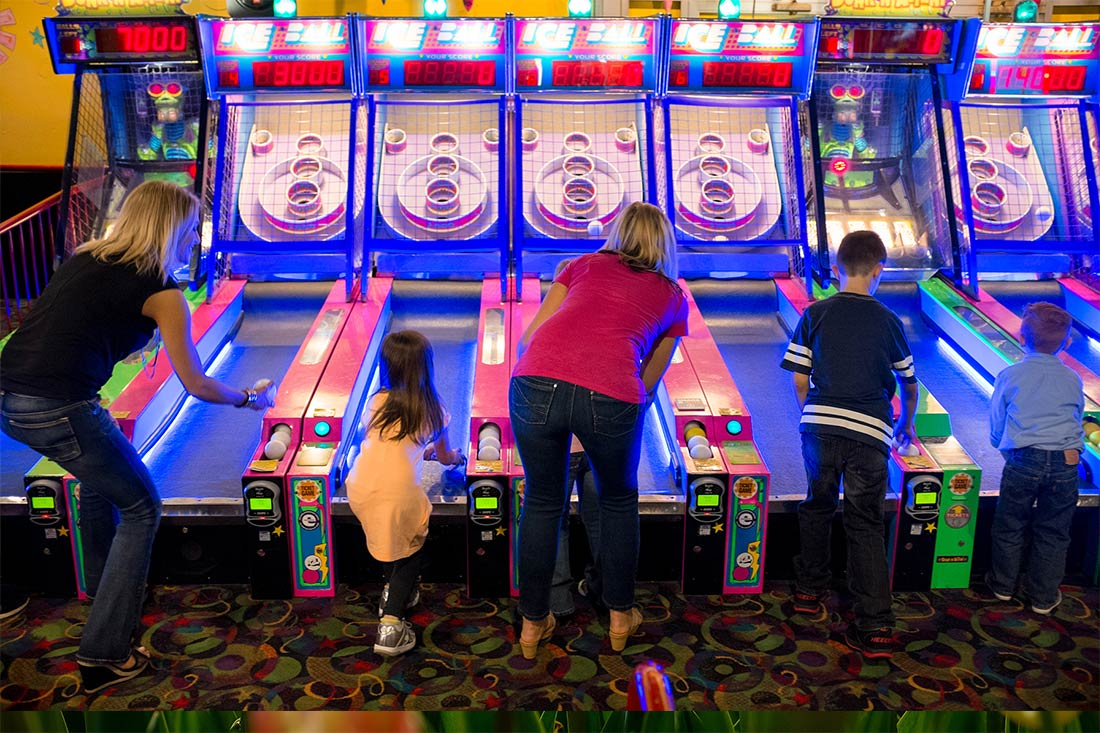 Family playing skeeball at Amazing Pizza Machine in Omaha, Nebraska