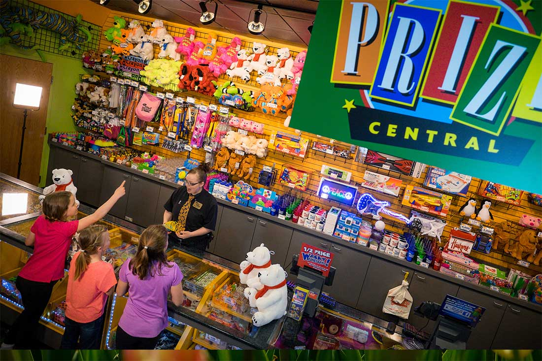 Kids redeem game tickets at Amazing Pizza Machine's Prize Central in Omaha, Nebraska