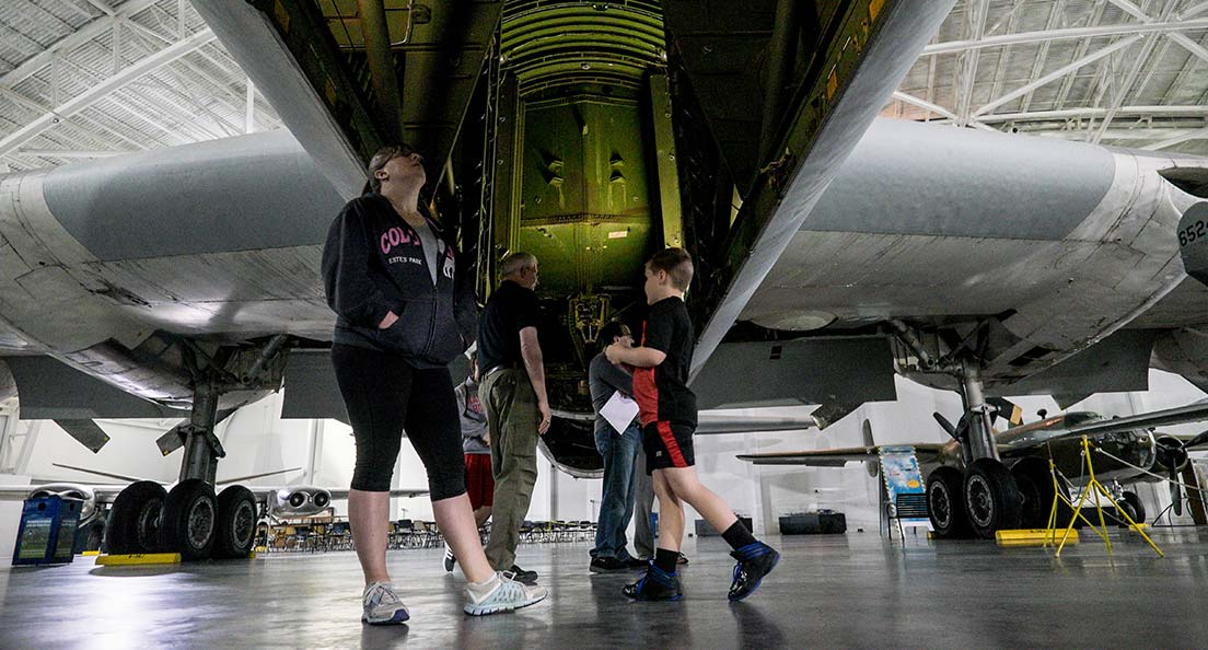 A family explores the underbelly of an airplane at the Strategic Air Command & Aerospace Museum in Omaha, Nebraska