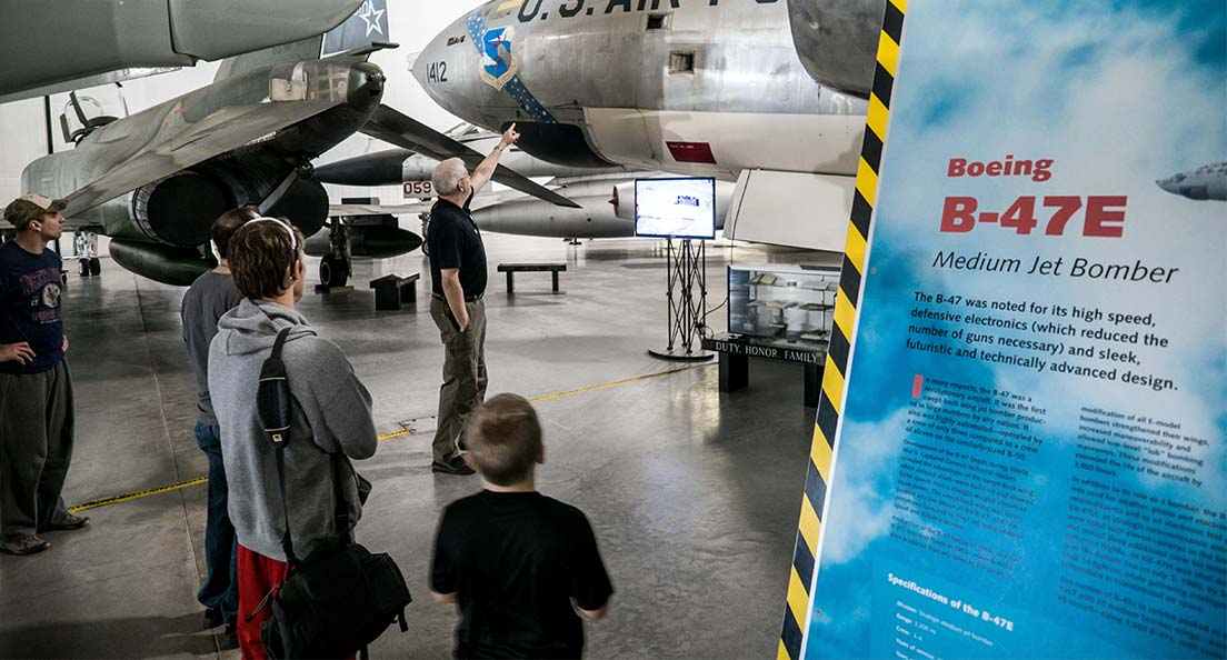 A docent leads a tour at the Strategic Air Command & Aerospace Museum in Omaha, Nebraska