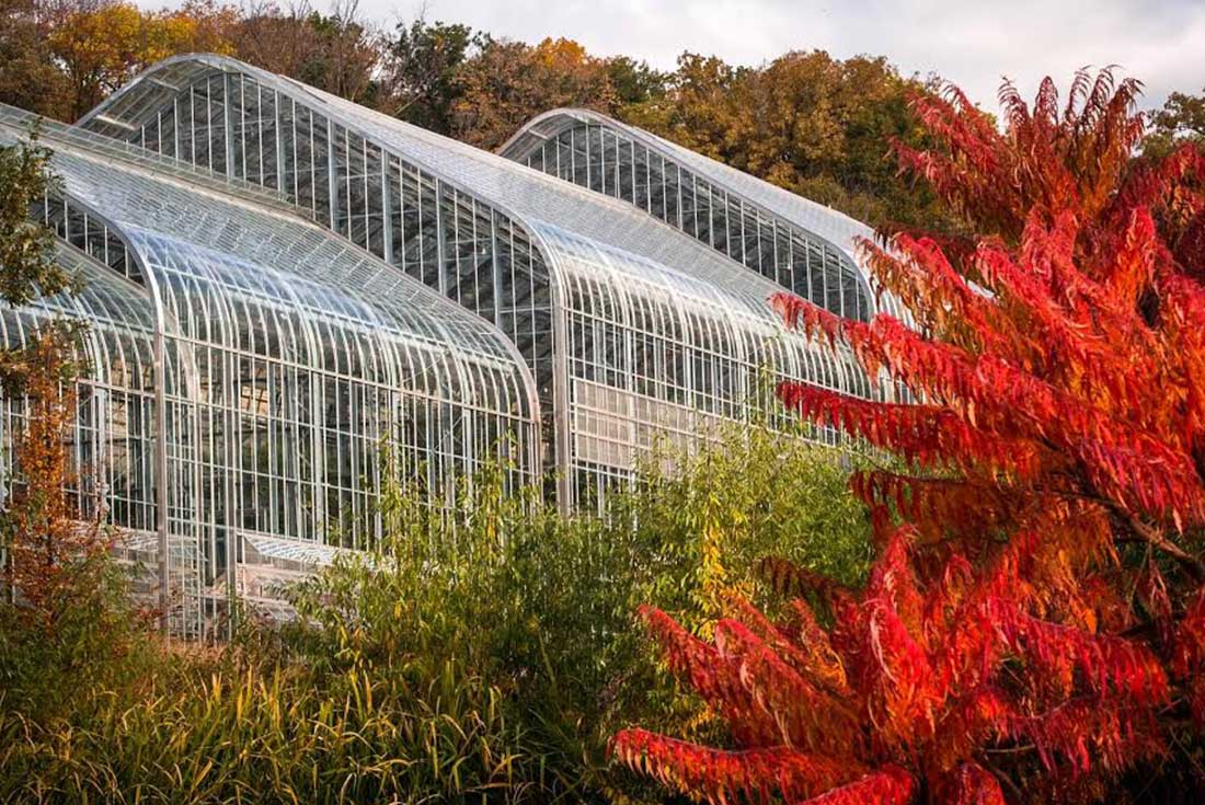 The Metal And Glass Marjorie K. Daugherty Conservatory In Omaha, Nebraska  Is Surrounded By