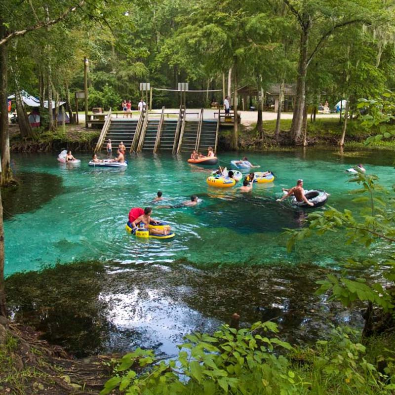 Families floating in tubes at Ginnie Springs in Columbia County, FL