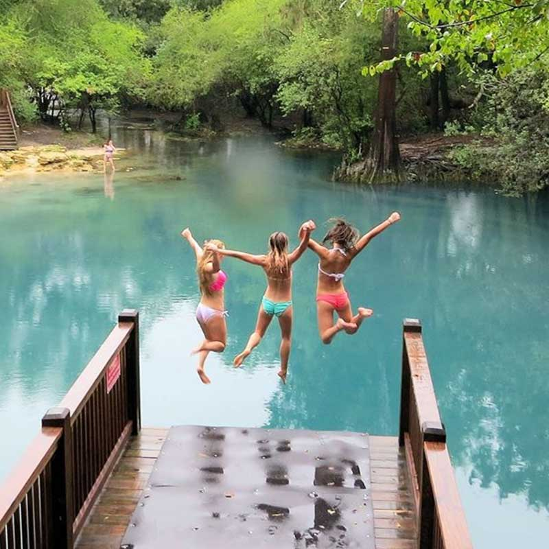 Children jumping into the Royal Springs in Columbia County, FL