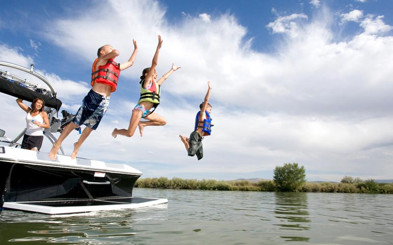 Family jumping from boat