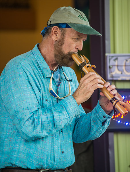 A performer plays a musical instrument at Railroad Square Art Park in Tallahassee, Florida