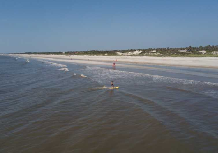 People enjoying the white sand beaches in Jacksonville, FL