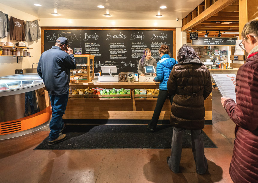 A cashier helps a line of customers at a cafe in Bend, Oregon