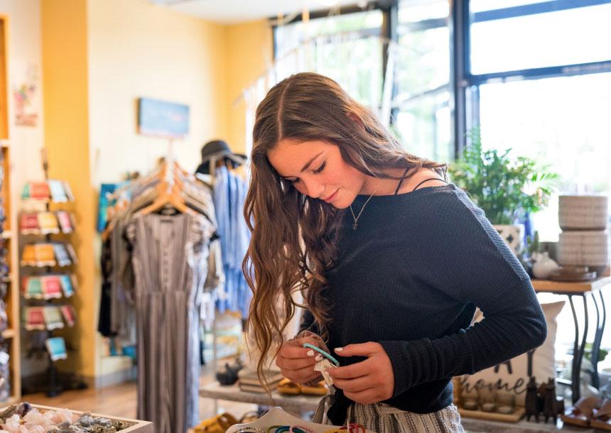 A teenage girl looks at bracelets in a shop in Bend, Oregon