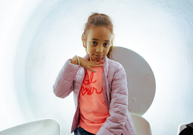 A young girl poses inside one of the tram cars at the St. Louis Gateway Arch.